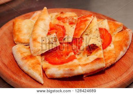 Italian Focaccia bread with tomato and cheese