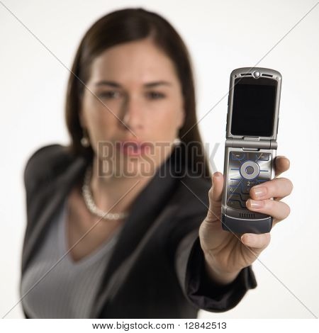 Caucasian mid adult professional business woman taking picture of self with camera phone.