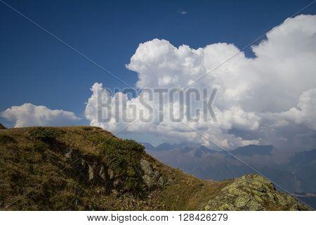 Mountain landscape with cumulus clouds