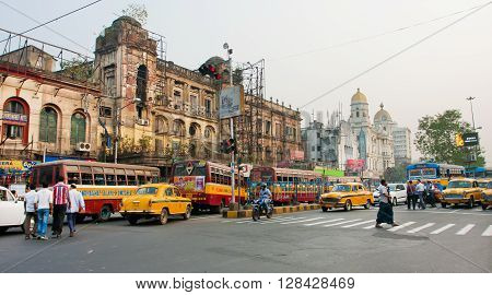 KOLKATA, INDIA - JAN 22, 2013: Panorama with traffic of taxi cars and different transport on old busy city road on January 22, 2013 in Calcutta. Kolkata has a density of 814.80 vehicles per km road length