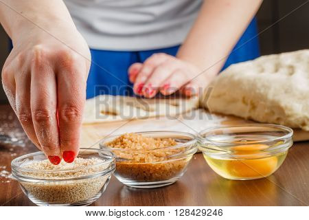 Baker Brings Dough Into The Desired Shape