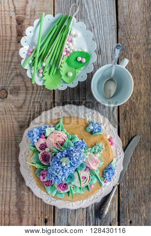 Dish With Cake And Decorative Elements From Sugar Mastic.