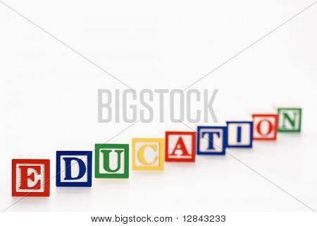 Alphabet toy building blocks spelling the word education.