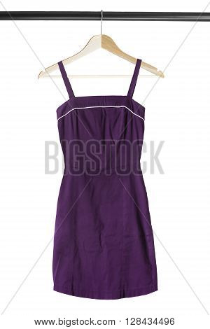 Purple sundress on wooden clothes rack isolated over white