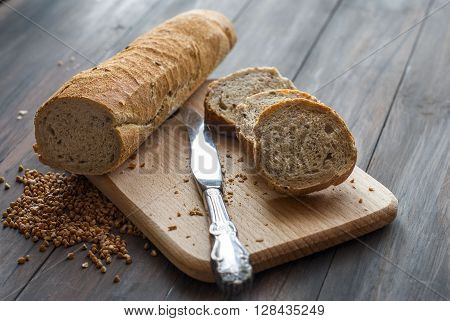 Natural homemade seeds and buckwheat bread on the wooden Board
