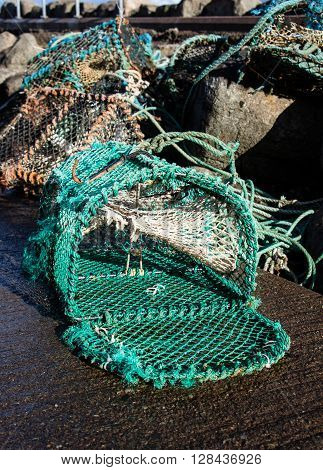 Open lobster pot on the harbour drying