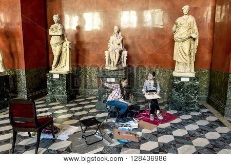 17 April 2016. Saint-Petersburg.Children draw Ancient sculptures in the hall of Greek sculptures in the state Hermitage Museum in Saint Petersburg.Russia.