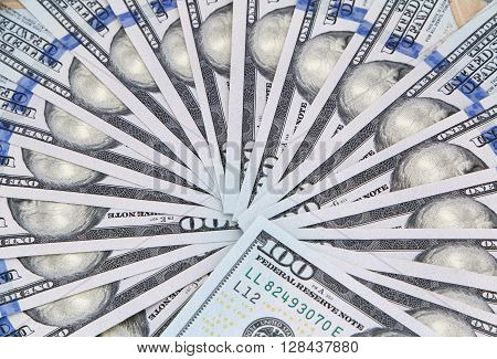 fan shaped one hundred dollars banknotes background