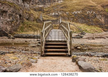 Steps up to a bridge of the river