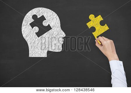 Human Head Puzzle to Complete on Blackboard Working Conceptual Business Concept