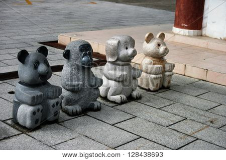 Four little animal statues in a row