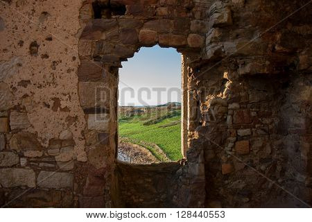 Old window in a ruin with grass beyond, Scotland