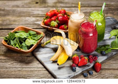 Assortment of milkshakes and smoothies on wooden table