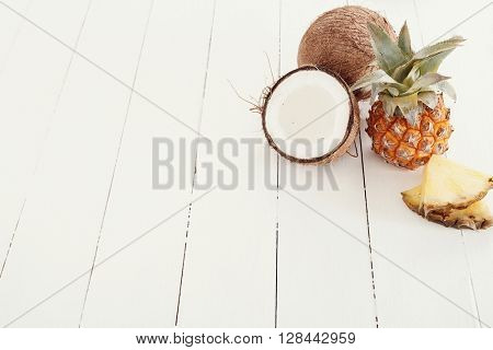 Pineapple with coconut on the table