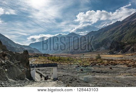 Himalayan glacier valley with village entrance. Annapurna trek in Nepal.