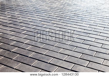 Grey paving stones as background close up