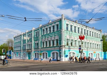 GOMEL BELARUS - May 1 2016: Unidentified people go near building of Public corporation Polespechat on Street Sovetskaya. Built in eighties of XIX century by architect E.K.Torlin before revolution - building of City Duma