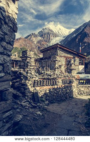 Traditional stone build village of Manang with Himalayas. Annapurna region in Nepal.