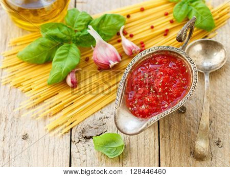Homemade tomato sauce for pasta and meat from fresh tomatoes with garlic Basil and spices. Selective focus