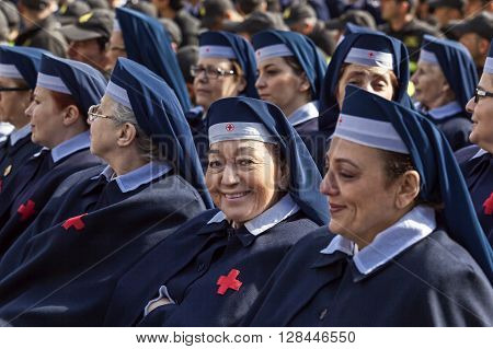 Rome Italy - April 30 2016: Women of the Red Cross volunteers deployed in St. Peter's Square on the occasion of the day dedicated to the jubilee of the military family and the police.