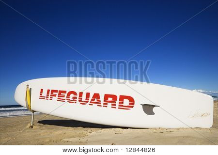 Lifeguard surfboard on beach in Surfers Paradise, Australia.