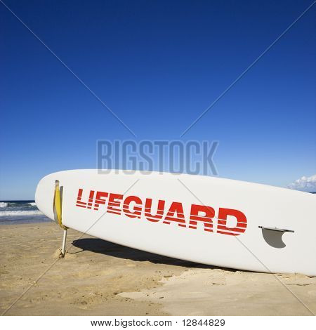 Lifeguard surfboard on beach in Surfers Paradise, Australia.