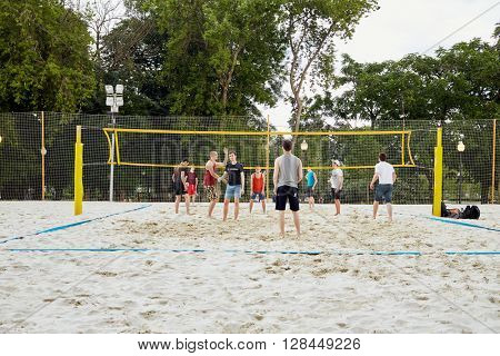 MOSCOW, RUSSIA - JUN 29, 2015: People play volleyball in Gorky Park in summer. Park located in centre of the city and has been founded in 1928, named by famous Russian writer Maxim Gorky in 1932.