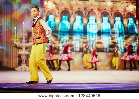 RUSSIA, KRASNOGORSK - DEC 12, 2014: Children dancing group performs in the gala concert of Moscow open all-russia festival Star Children on the stage in the House of Moscow Oblast Government.