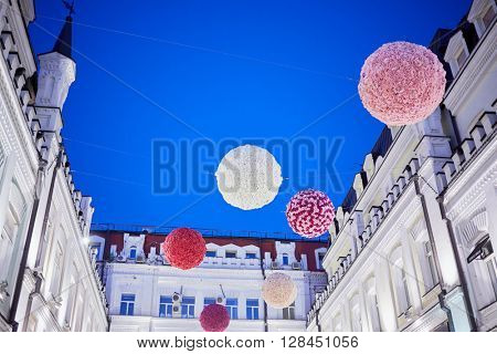 MOSCOW, RUSSIA - JUN 22, 2015: Hanging balls in Tretyakovsky proezd in the evening. Street was built in the 1870-s by brothers-sponsors Tretyakov.