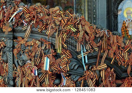 The ribbons on the gates of the Cathedral put there by parishioners of the Church on Christian holidays