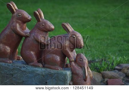 Conceptual sculpture of four rabbit rescue another rabbit out of the water Sculpture of four rabbits are rescue another rabbit out of the water. Limpopo Zoo Nizhny Novgorod