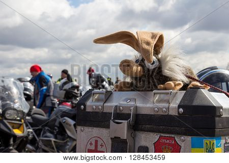 Moscow Russia - April 23 2016: Motorcyclists open the spring season. Toy dragon on a motorcycle seat.