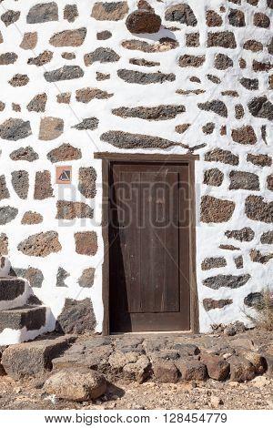 Door in stone wall