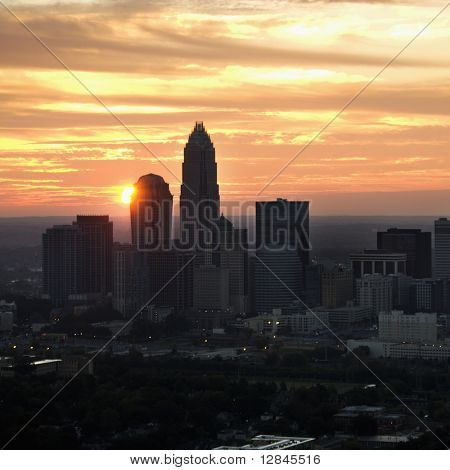 Aerial view of sunset behind city skyline of Charlotte, North Carolina.