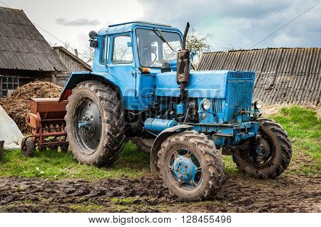 Old blue Belarus tractor on a ground