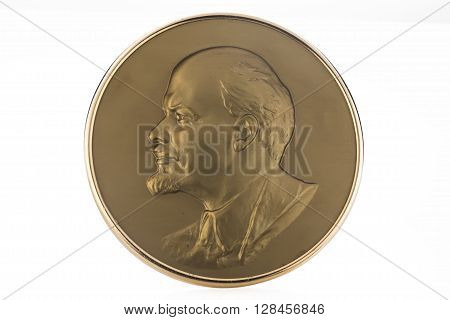 Medallion with soviet leader Vladimir Lenin isolated on white