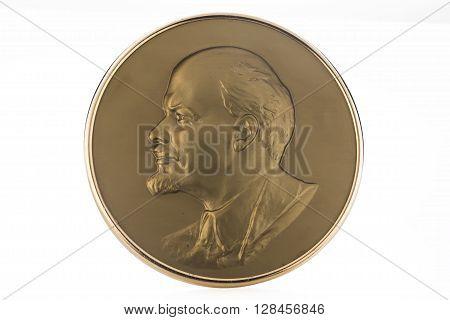 Medallion with soviet leader Vladimir Lenin isolated on white