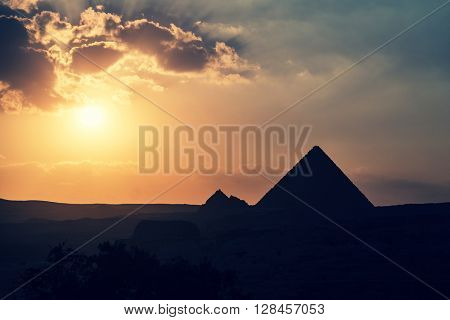 The Great Pyramid of Giza at sunset. Cross processed with filter.