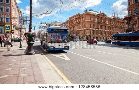 SAINT PETERSBURG RUSSIA - AUGUST 5 2015: Passenger bus run on dedicated bus lanes on the Nevsky Prospect in summer day
