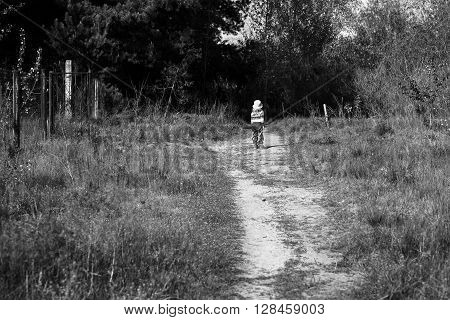Little Girl On The Threshold Of A Dark Forest Black And White