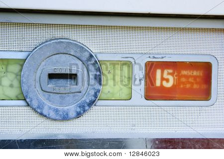 Coin slot and fifteen cent price on old vending machine