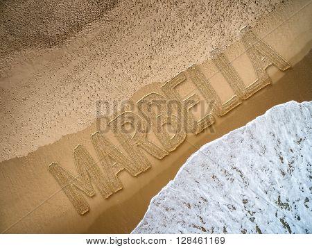 Marbella written on the beach