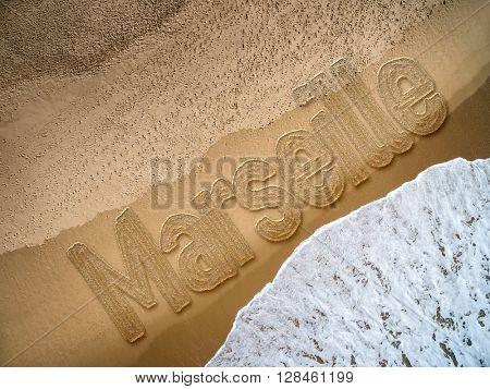 Marseille written on the beach