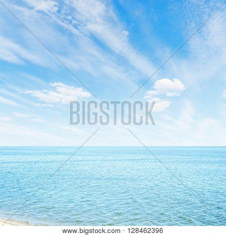 white clouds in blue sky over sea