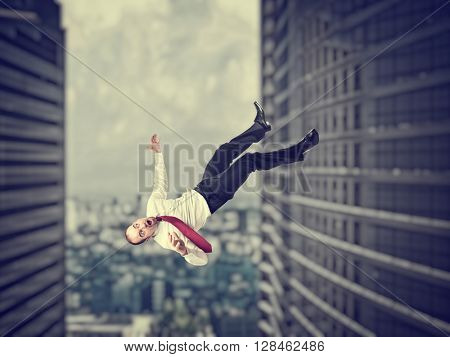 falling businessman and modern 3d urban background