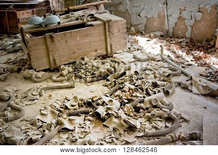 Gas masks lay scattered on the floor of abandoned building, Pripyat, Chernobyl Exclusion Zone, place of Chernobyl nuclear disaster in Ukraine