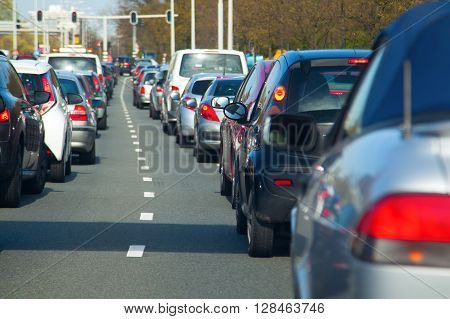 rows of cars in a traffic jam with small depth of field