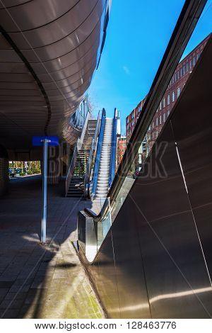 escalators at a tram station in a big city