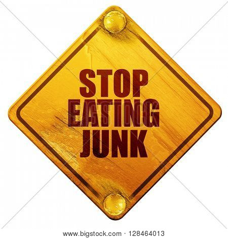 stop eating junk, 3D rendering, isolated grunge yellow road sign