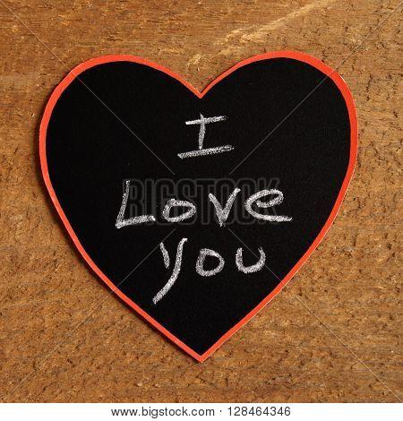 A chalkboard message with I Love You handwritten inside a heart shape.